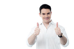 Successful man showing thumbs up gesture Royalty Free Stock Photography