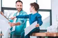 Successful man spending time with the son. Beloved son. Successful men spending time with the son while staying in an office royalty free stock images
