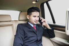 Successful man talking on the phone in car Stock Image