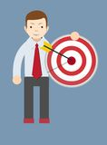 Successful man or teacher holding a target with Royalty Free Stock Photography