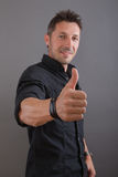 Successful man with thumbs up Stock Photo
