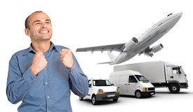 Successful man and transportation fleet. Happy man with satisfied expression by a transport fleet royalty free stock photos