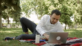Successful man working on the field with laptop stock video footage