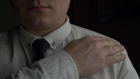 Successful manager or businessman in white shirt in dark office. Successful manager or businessman in white shirt with tie in dark office stock footage