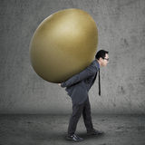Successful manager carrying golden egg Royalty Free Stock Photography