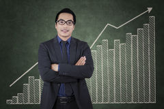 Successful manager with growing financial statistics Royalty Free Stock Images