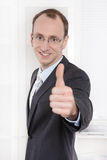 Successful manager happy with thumbs up and glasses Royalty Free Stock Image