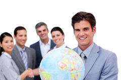 Successful manager and his team holding a globe Stock Photos