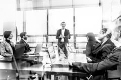 Successful manager leading corporate business team office meeting. royalty free stock images