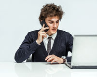 Successful Manager man speaks on the phone with customers Stock Photo