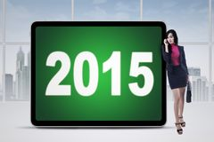 Successful manager at office with numbers 2015 Stock Photography