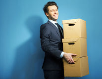 Successful manager with the paper boxes Royalty Free Stock Photography