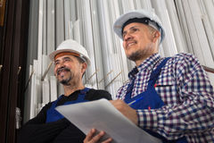 Successful manager with papers and workman in helmet Stock Image