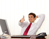Successful Manager sits at a desk Stock Photo