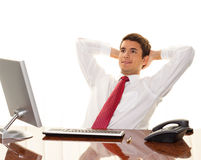Successful Manager sits at a desk Stock Images