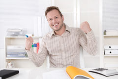 Successful manager sitting at office - positive. Stock Image