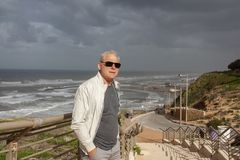 Successful matur man on the background of the sea stock photos