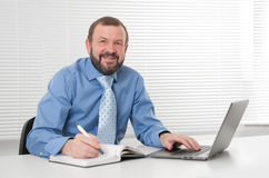 Successful mature business man smiling Royalty Free Stock Photos