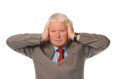Successful Mature Businessman Covering Ears Stock Image
