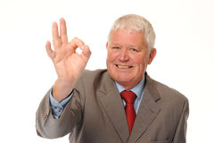 Successful Mature Businessman Giving Okay Sign Royalty Free Stock Photography