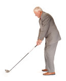 Successful mature businessman with golf club Stock Photos