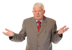 Successful mature businessman shrugging Stock Photo
