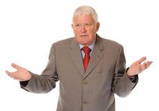 Successful Mature Businessman Shrugging Stock Photo