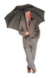 Successful mature businessman with umbrella Royalty Free Stock Photo