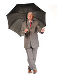 Successful mature businessman with umbrella Stock Photography