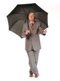 Successful Mature Businessman With Umbrella Stock Photography