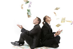 Successful men throw a money up. Isolated stock photos