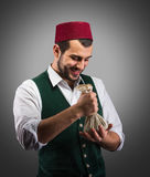 Successful merchant, concept. Smiling merchant looking at money, concept Royalty Free Stock Photos