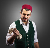 Successful merchant, concept. Smiling merchant looking at money, concept Royalty Free Stock Photography
