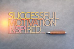 Successful motivation inspired paper text shape with wooden pen. On grey background royalty free stock images