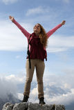 Successful mountaineer on top of a mountain Royalty Free Stock Images