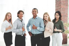 Successful multinational business team showing thumb up royalty free stock photos