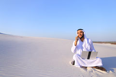 Successful Muslim male architect communicates on phone with clie Stock Photography