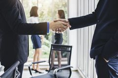 Successful negotiate or corporation of partnership, business peo. Ple hands shake in meeting room royalty free stock image
