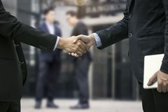 Successful negotiating business concept, Close up hand of businessmen shaking hands after finishing meeting or setting goals and. Planning way to success royalty free stock photos