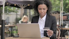 Successful Online Shopping by Young Woman Sitting on Bench stock footage