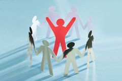 Successful paperman surrounded by team representing unity Royalty Free Stock Photos