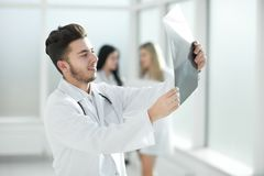 Successful pediatrician standing in the hallway of the medical center. Photo with copy space stock photography