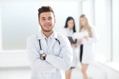 Successful pediatrician standing in the hallway of the medical center. Photo with copy space stock photos