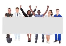 Successful people with different occupations holding billboard Stock Image
