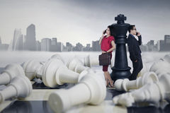 Successful people lean on the chess queen Royalty Free Stock Image