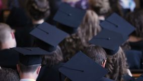 Successful people in mortarboards ready to receive higher education diplomas. Stock footage stock video footage