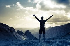 Successful people sport, motivation, inspiration. Silhouette of successful man on the top of mountain. Concept of sport motivation inspiration Stock Photo