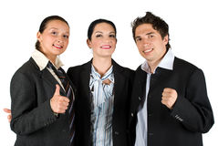 Successful people team work. Successful group of three people teamwork hugging and standing closed one to each other and showing happy faces and thumb up,check Royalty Free Stock Photos