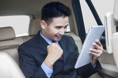Successful person with tablet inside the car Stock Photo