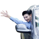 Successful person waving hand in the car Royalty Free Stock Photos